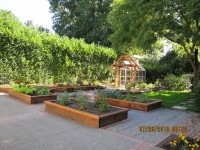 Landscape with planters, greenhouse & arbor